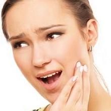 Triệu chứng viêm quanh cuống răng là gì?